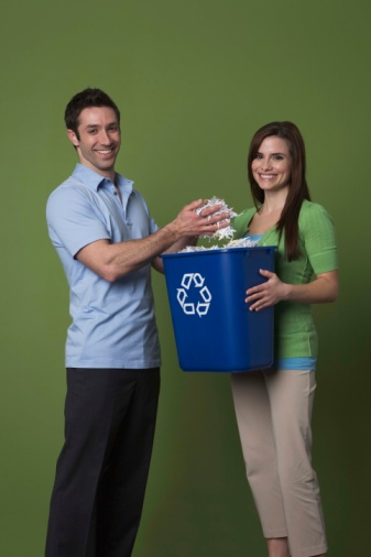 Couple with recycling bin
